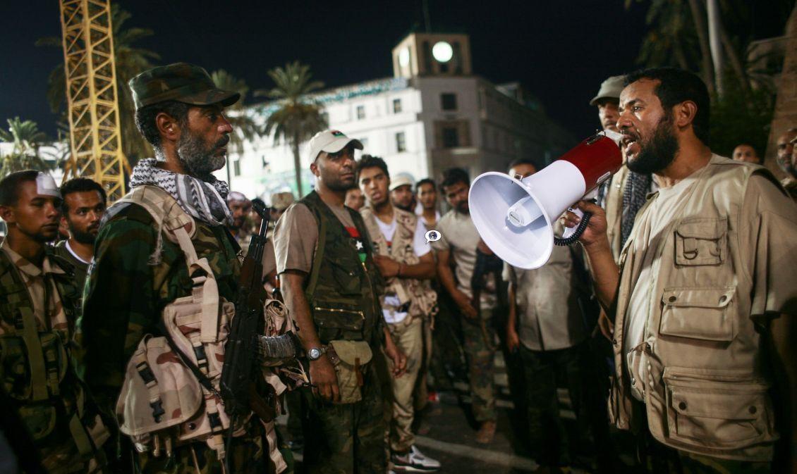 Tijekom rata u Libiji 2011. godine, Belhadj je bio jedan od plaćenika koji se borio pod zapovjedništvom NATO-a, bio je vođa oružane terorističke milicije koja je sudjelovala u oduzimanju i uništenju državnih institucija u Tripoliju.